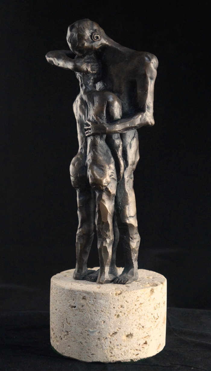 two figures-embracing